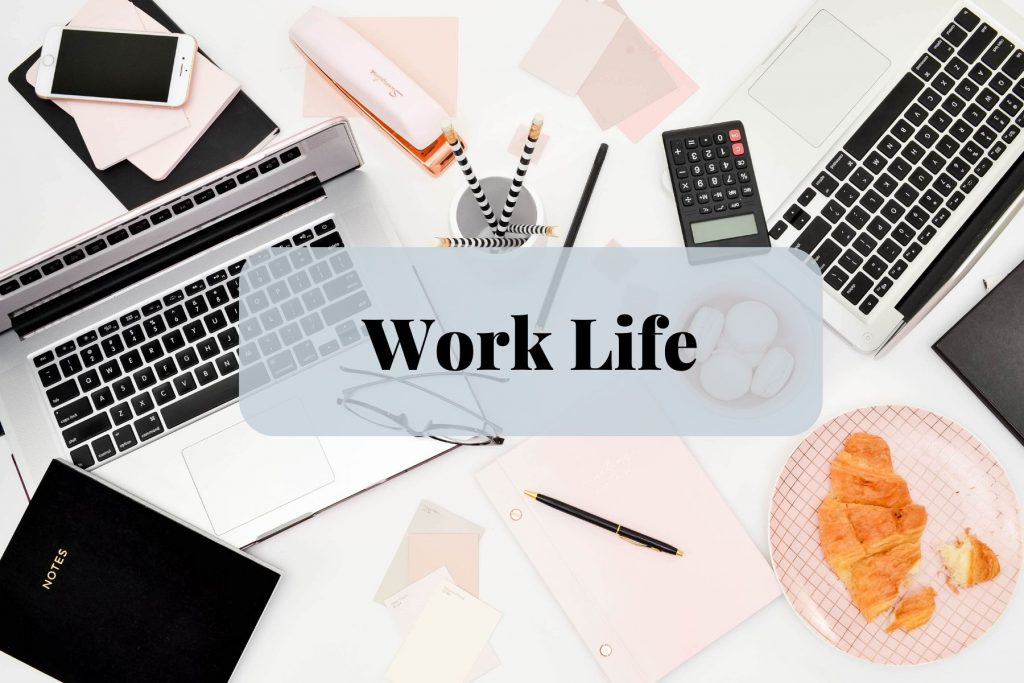 "Two laptops with scattered papers and snacks overlay text that says, ""Work Life"""